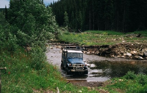 2. Me driving thru creek.JPG