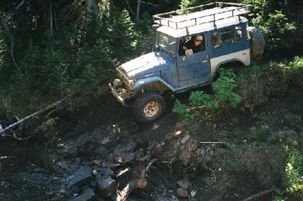 6. Me dropping into creek.JPG