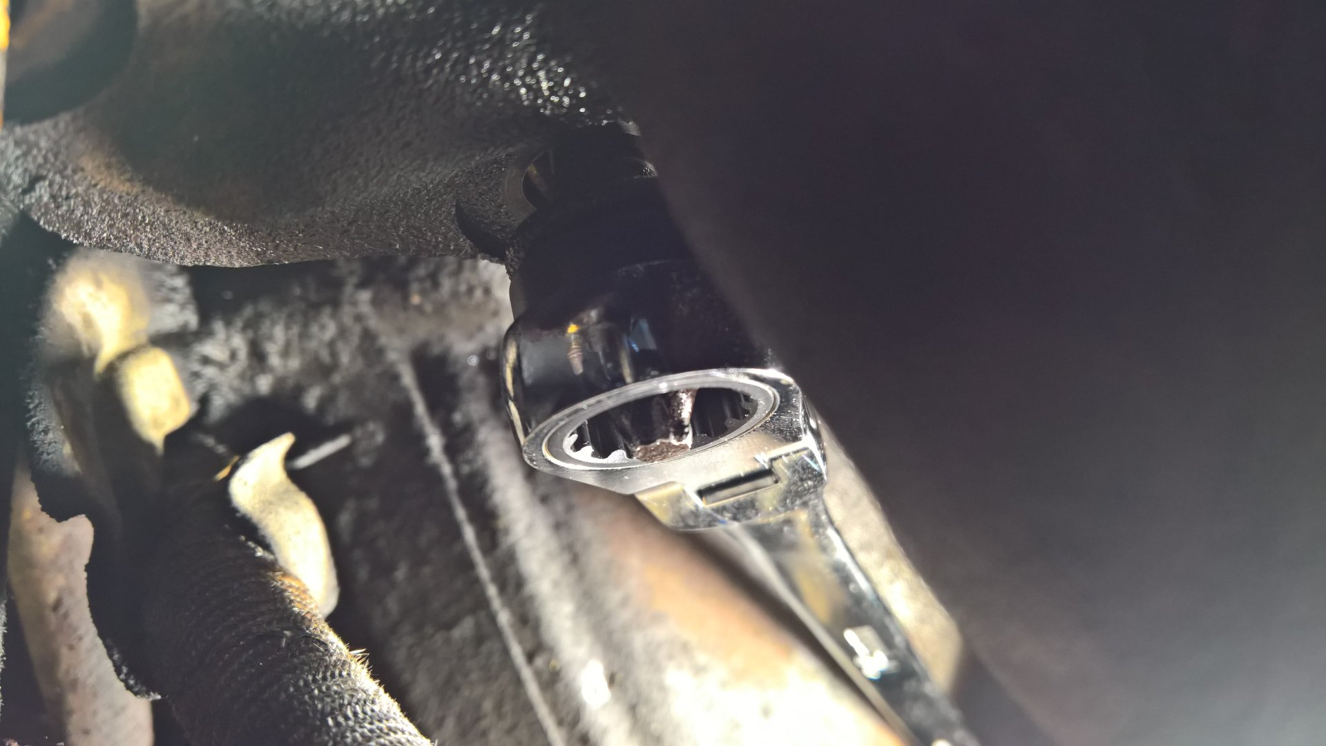 Exhaust manifold nut removal from below viewing wrench from abovve.jpg