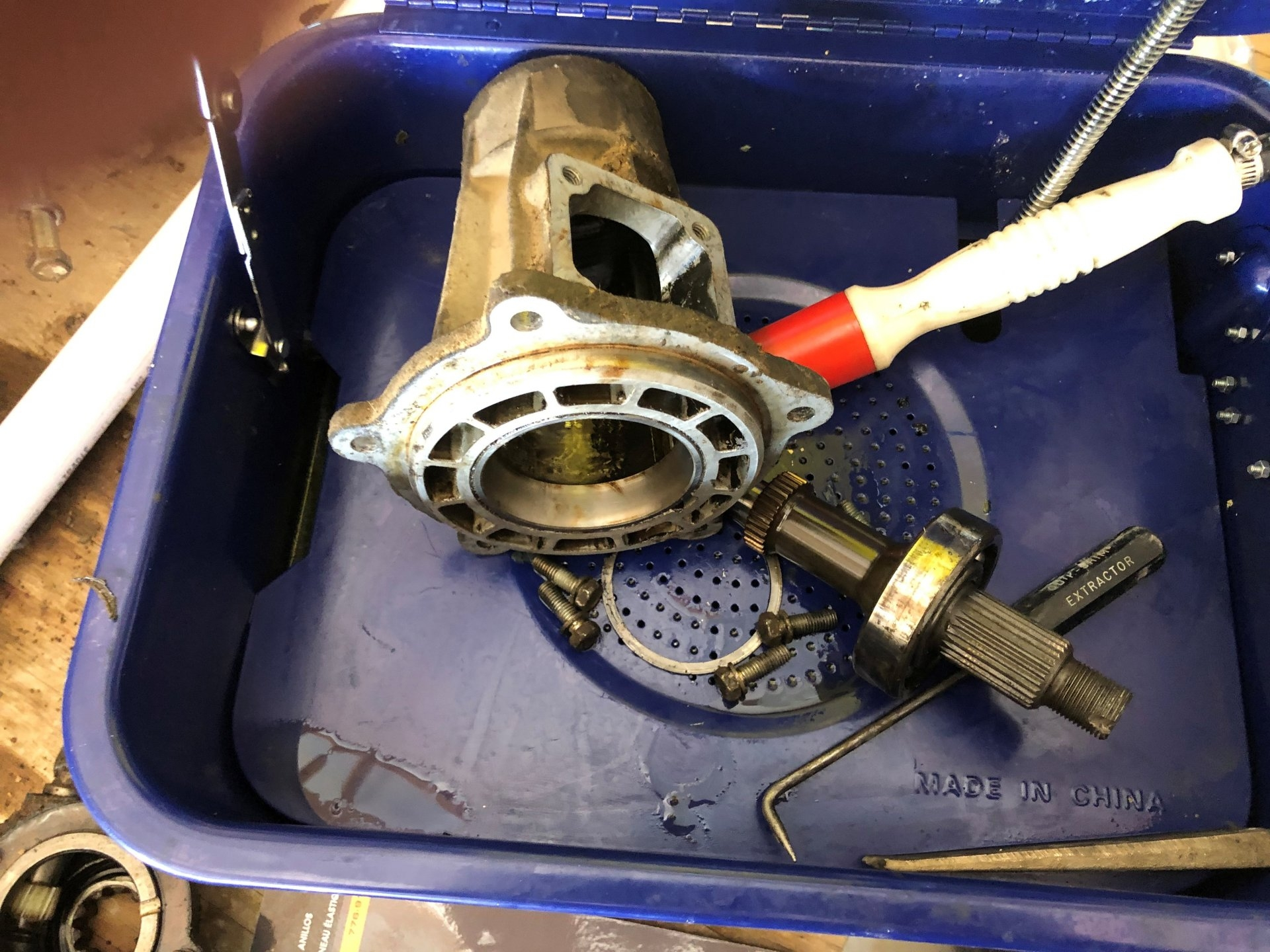 FRONT OUTPUT SHAFT AND CONE READY FOR CLEANING.jpg