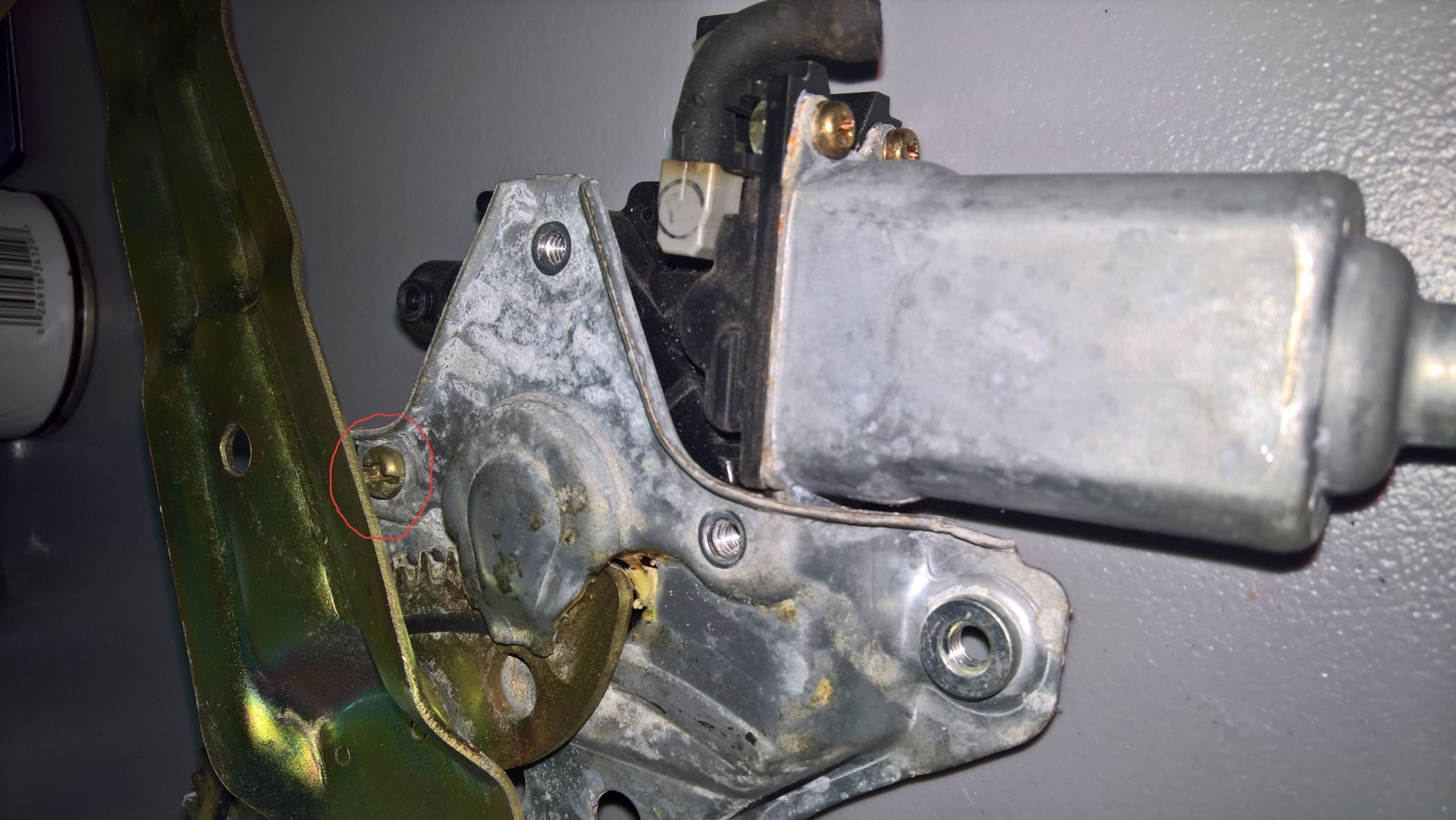 FZJ80 Rear window lift motor inaccessible torx screw circled red.jpg