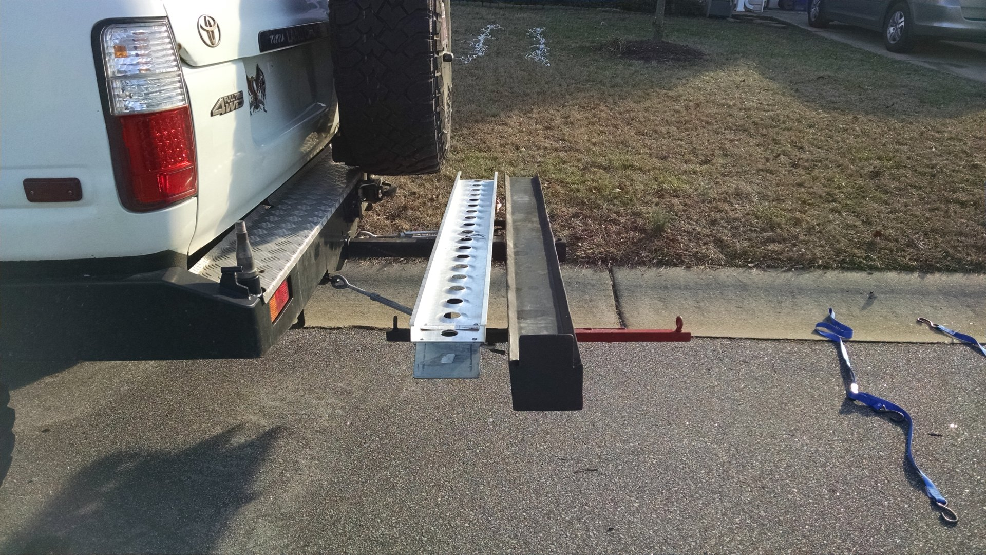 Motorcycle hitch carrier and dual swing