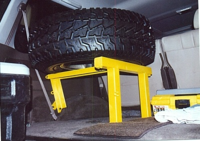 spare tire inside with tool box below b.jpg