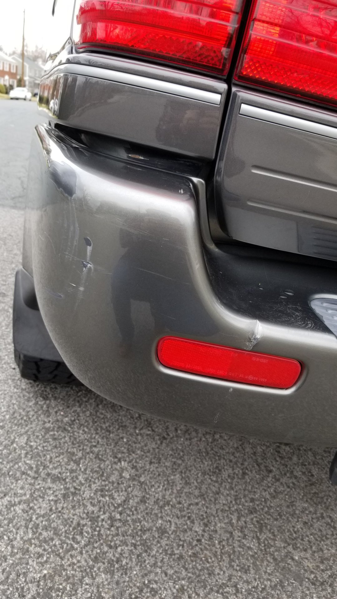 Another Close view of scratches/dent left rear bumper